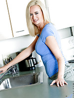 Milf Camryn Cross flaunts her curvy body in the kitchen and massages her big boobs